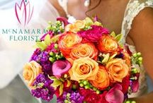 Congrats Mr. & Mrs. Pence / This wedding used bright pinks, oranges and golds. These arrangements are fun and festive and add pops of color to the reception area and tables. Floral Designs by McNamara Florist. All Rights Reserved.
