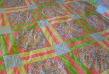 """Stack and Wack quilt / These are really fun to do as no 2 squares come out the same. Plus its a way to use those really big prints. The ones where you look at it and wonder """"what were they thinking when they made this""""?  / by Lisa Shingleton"""