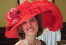 """My Friend Beth wearing East Angel Harbor Hats / Quote from Beth: """"I live in Virginia and attend red and black hatter events and themed teas.  I'm a Queen in the Red Hat Society--we dress in dark purple outfits and red hats; for our birthday month we reverse colors and wear red outfits and dark purple hats.  I love the gorgeous hats that East Angel Harbor Hats creates—they're truly quality heirloom products. No matter what the occasion I can purchase a stunning and quality hat from East Angel Harbor Hats that I will cherish for years to come."""""""