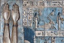 Ancient Egypt / Post and lintel system. Columns elaborately decorated with scenes, stories, lotus flowers, hieroglyphics, palm leaf, rope and feather design. Frontalism