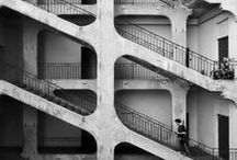 Brutalism / 1950s-1970s. Developed from design elements of the Modernist Era. Concrete, rough blocky texture, futuristic shapes, function has priority, 'truth to materials'.  Architects: Alison and Peter Smithson, Le Corbusier, Erno Goldfinger