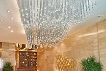 Sparkling Wave Lighting Fixture - Intourist Hotel Baku / Crystal cut balls, the typical components used for classical chandeliers, create modern sparkling waves lighting up the hotel lobby and the restaurant.   Placed in the historic building of the Intourist Hotel in Baku, The Sparkling wave by Sans Souci watches over the comings and goings on one of the longest seaside promenades in the world. In addition to this, a light crystal rain descends on the heads of B&B Restaurant's guests.