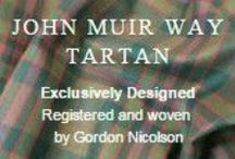 John Muir Way Tartan / Gordon Nicolson Kiltmakers designed the John Muir Way Tartan to mark the opening of the John Muir Way on 21st April 2014.    The inspiration for the colours incorporated in Gordon's design came from his surroundings.  - Green and Brown  - Nature Red - from the Dunbar tartan where John Muir was born   - Blue - the Sea and Sky.   The Tartan has been approved by Scottish Natural Heritage and has been registered by the Scottish Register Of Tartans.