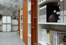 PROFCASE storage / A BOOKCASE SYSTEM available in various heights and three widths allowing the maximum flexibility and composing freedom. Closed swing or push to open doors spaces and open insert arrange the site according to any personal need. The large program modularity and the finishing range always allow the original reading of the modern office site.