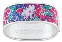Bijoux CACHAREL bracelet rigide / Bracelet CACHAREL rigide : en argent rhodié, laque de couleur et oxydes de zirconium. Le bijou se mêle dans la gamme, une pointe de féminité poétique libre et décidée, résolument ancrée dans son temps. http://www.bijouterie-influences.com/search.php?search_query=bracelet+rigide+cacharel