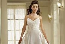 Wedding Dresses / You've found your true love and the time has come to tie the knot and begin your life together. What comes next – the perfect wedding dress! Just imagine it, as you glide elegantly down the aisle and you watch your future husband's face light up and you know you are wearing the perfect gown.