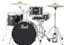 Beginner's Gear Guide: Drums / Picking out your first drum set can be a daunting task. Should you get an acoustic or electronic kit? What kind of cymbals will you need? What actually comes with the drum kit...and what additional parts will you need? Check out this guide and find out exactly what you need to get rocking.