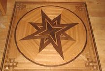 Inlay Flooring /  Inlays are produced to be compatible with standard flooring specifications.  Our inlay craftsmen also are able to custom match wood species and installation profiles to any manufacturer's product.