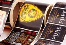 Labels / From 1 to 1 Million, Fascia Graphics® manufacture high quality self-adhesive labels on rolls or sheets utilising screen, digital, hot-foil and lithographic printing technologies.
