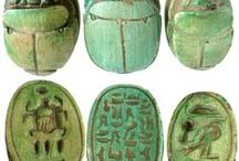 """The Great Scarab Scam, A Mystery for Young Readers / Eleven-year-old Lydia Hartley dreams of following in the footsteps of her archaeologist father. When he goes to Egypt to help track down the culprits responsible for the """"scarab scam,"""" an operation dealing in forged antiquities, Lydia gets the chance to travel along with him.   However, once she's in Egypt, Lydia learns there is more at stake for both her father and her Egyptian hosts than mere scarabs, especially for twelve-year-old Sima Malik--and only Lydia knows what to do."""