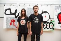 Max Gimblett x Martin Poppelwell Collaboration / Long time Workshop partners Max Gimblett and Martin Poppelwell collaborated together for the first time specifically for this project. The works were created over four days at Poppelwell's studios on Bluff Hill, Napier, from which elements have been translated onto limited edition Workshop garments.  Photography by Sam Lee