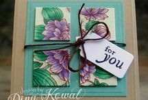 """Cards: Inchies / What is an """"Inchie""""? It's a sturdy square 1x1 inch piece of art work. You can make them in paper, fabric, wood, metal etc. using any medium. They are great in collage cards as the samples show below. """"Twinchies"""" are 2x2 inch squares. """"Rinchies"""" are 1"""" circular artwork that can fit inside a flattened bottlecap"""