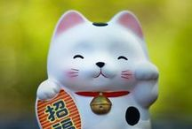 "Maneki Neko / Maneki-Neko, Lucky Cat, Beckoning Cat, or ""that thing keeps waving al the time"". You've come to the right place"