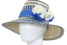 IRACA Hat Collection / All PUTCHIPUU hats are 100% handmade from the highest quality IRAKA Palm Straw located in the high desert of La Guajira, Colombia. Each hat is unique with whimsical handwoven designs, taking up to 8 hours to weave. Trim and pom poms are 100% cotton. By purchasing one of these hats you are helping sustain the economic growth of the Wayuu people.   This hat is handmade using weaving techniques. sizes, patterns, shading and details may vary.