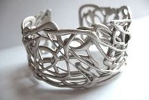 Unique Jewelry / Not necessarily made here in our store.  Silver, gold, rose, white.  14kt, 18kt, sterling silver.  Antique, modern, contemporary, vintage.Rings, bracelets, necklaces, earrings, gemstones, diamonds.