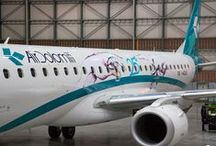 """Air Dolomiti - Special Livery 25 / To celebrate its silver anniversary milestone, Air Dolomiti adds the artwork """"Reaching Out"""" to the livery of its iconic Embraer 195 (IADJS). Serafino Rudari found inspiration in the theme of meetings, with two hands stretched out towards each other and a logo symbolising this 25th anniversary. #airdolomiti25 #speciallivery #serafinorudari #embraer"""