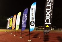 Banners & Feather Flags / Banners, mesh fence screens, feather flags, vinyl banners, backdrops, point of sale banners and more.  http://www.pixus.com/products-services/banners.html / by Pixus Digital Printing