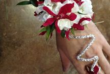 Wire / creative prom designs made with,  or accented with decorative wire.  Wrist corsages, Wire creations that wrap around your arm, necklaces & boutonniere styles.