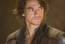 Richard Cypher / Rahl - Legend of the Seeker - Craig Horner / Richard Rahl/Richard Cypher, is the adopted son of George Cypher. His real father is named Darken Rahl (in the series, Darken Rahl is Richard's brother). He is friends with the first wizard Zeddicus Zu'l Zorander. He learns more about his heritage and his gift, facilitating his role as the Seeker of Truth and the master of D'Hara. Richard is in love with Kahlan Amnell and sees her as the only reason he lives.