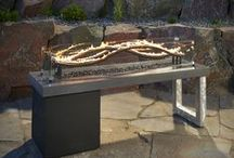 Backyard Firepits / Outdoor living can be a refreshing swim in your new pool on a hot summer day, or it might be a fun night with s'mores around the fire pit on a crisp fall night. Entertaining all year long could include an outdoor living area complete with kitchen, fire place, TV, sound, bar, an overhead structure, for our welcomed winter visitors, a warm and therapeutic spa can be just the thing on a crisp Arizonan night.