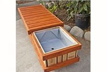 """Rolling Planter Bench / Have you ever wanted to hang out in your garden.  Has there been times when you find that want to stop work, rest and admire your plants - """"Smell the Roses,"""" if we might say. Our attractive multifunctional bench allows you to plant, sit, store and move it.    Mobile, Water proof, made of a heavy duty solid plank system.   Fully assembled handmade planters.  Built commercial grade tough to endure many years of continuous gardening."""