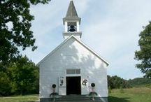 """The Chapel at Shore Acres / The Chapel is built in the simple vernacular style of the """"old white country church"""" and still has all of its original windows and floors. The refinished pews will hold up to 75 people. Placed in the serene setting of Shore Acres Park, the church is a beautiful venue for weddings, services, and other events."""