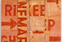 Rosalie Gascoigne (1917 – 1999) / Collages made from found objects such as weather worn wood and reflective road signs, often incorporating typography. Rosalie's first exhibition was at age 57.