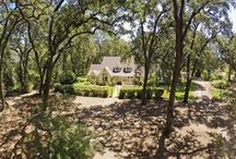 Panoramic Vineyard View Property / Surrounded by vineyards and nestled amid Heritage Valley Oaks, graceful farmhouse (approx. 4075 SqFt) with adjoining guesthouse (approx. 1200 SqFt) tucked away at end of gated private lane. / by Heritage Sotheby's International Realty