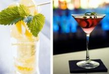 Cocktail time / Raised glasses. Shimmering candles. Make your happy hour the talk of the town.