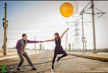 engagement photography: tyler & emma / Emma and Tyler love Los Angeles, so we shot their engagement photos all around town. We started at the 4th Street bridge downtown, playing with some jumbo balloons in the street (warning: do not try this at home). Then we went over to Griffith Park for some fun among the trains at Travel Town and lawn near the Merry-Go-Round.