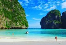 Phi Phi Islands, Thailand / Phi Phi - the true celebrity among all the Thailand islands! Crystal clear emerald water surrounds the white sand beaches contrasting with the towering dark coastal cliffs and bright green vegetation. A real paradise on earth, Phi Phi is the place to escape, relax and disconnect as you stare at the surrounding beauty.