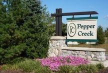 "Courtyards at Pepper Creek, Valparaiso, IN - an Epcon Community / Nestled in the Pepper Creek subdivision, enjoy surrounding ponds, woods, and meandering walking paths. Enjoy a dip in the private outdoor swimming pool, stay fit in the community fitness center, host a party in the private community center, or watch a game and relax in the billiards room. You'll appreciate the rich ""Heritage Stone"" exterior elevations and the full exterior maintenance services providing you a new carefree lifestyle."