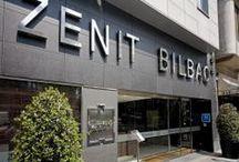 Zenit Bilbao / El Zenit Bilbao se encuentra en el céntrico barrio de Indautxu de Bilbao, a 10 minutos del estadio del Athletic de Bilbao, San Mamés. Ofrece un gimnasio y elegantes habitaciones con conexión inalámbrica a internet gratuita y TV vía satélite. Hotel Zenit Bilbao, C/ Autonomía, 58 48012, Bilbao, VIZCAYA, España Telf 944108108 Email: reservasbilbao@zenithoteles.com; http://bilbao.zenithoteles.com/