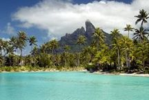 """DISCOVER: Bora Bora / Bora Bora, """"The Romantic Island,"""" is often called the most beautiful island in the world. This tiny island – just 18 miles in circumference – is encircled by a protective necklace of coral. Arriving by air is a unique experience, landing on the airstrip that was built by U.S. troops during World War II. The runway is on a motu (small islet), and visitors must travel by boat to reach the main island."""