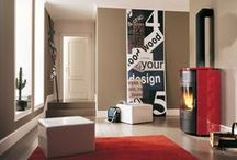 Red Wood Pellet Stoves and interior design inspiration / Pictures of red wood pellet stoves. Pictures of wood pellet stoves that compliment red as an interior design colour.