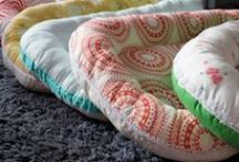 robben nests / The Robben Nest is a cocoon with a thin mattress and soft padded edges which offers a safe and cosy bed for your baby. The sleeping space created by the nest gives security to your baby similar to the enclosed space of the womb, ideal for settling and sound sleeping as they adjust to life outside their mother's body. Use your Robben Nest as a protective space for safe co-sleeping in your bed, or for comfortable sleeping in the bassinet, cot, buggy, or other flat surface.