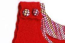 Trägerkleid Rosalie / hat eine Herztasche auf der Vorderseite und kann am Rücken durch ein Band individuell angepasst werden