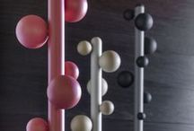 Bubbles coat rack / The main goal of the Bubbles coat rack was to remove as much as possible without losing its functionality. The coat rack is composed of a central metal stem with spherical wooden holders of varying sizes that appear to be placed randomly. The coat stands are available in different colours and finishes.