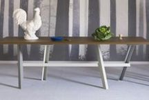 Perch dining table / Inspired by construction and building materials, the Perch dining table is characterized by four bent steel slanted legs that look as if they are leaning casually on the central beam, which has the unique ability of creating a long freestanding table. The tables are available in various lengths, colours, and tabletops.