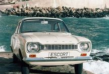 Ford Escort / Launched in January 1968 as a replacement for the Anglia and using much of the same technology – MacPherson strut front suspension, a leaf-sprung live rear axle, slick-shifting four-speed all-synchromesh gearbox and pushrod four-cylinder engine – the Escort was a roomier, sleeker package and available with two or four doors, as an estate or as a van. It had sharper rack and pinion steering, while Ford engineers spent considerable time eradicating Noise, Vibration and Harshness.
