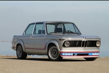 BMW 2002 / The inspiration behind all the great BMW's since the Seventies, the 2002 still retains an air of cool. The BMW 2002 has since gone down in history as an automotive icon. Wrapped in the pretty Michelotti-penned two-door body-shell that was debuted on the 1602, with an energetic 2-litre lump under the hood, the 2002 enhanced BMW's reputation for compact sporting saloons, particularly so when the later 2002tii and Turbo models arrived.