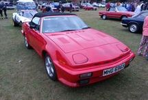 """Triumph TR8 / The Triumph TR8 is an eight-cylinder version of the """"wedge-shaped"""" Triumph TR7 sports car, designed by Harris Mann, and manufactured by British Leyland, through its Jaguar/Rover/Triumph division. Because of its outstanding performance, the TR8 was often dubbed the """"English Corvette"""". The majority of TR8s were sold in the United States and Canada."""