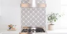Hooded Ranges + Tile Backsplashes / Looking for ways to highlight your hooded range? We've rounded up 10 of our favorites. These tile backsplash and hood pairings offer the perfect balance of form and function.