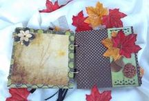Fall Scrapbook Mini Album / Another example of some earlier work! This Mini Scrapbook is made of Chipboard covers, and card stock pages.  It is decorated with an array of Scrapbook Papers from different collections, that represent everything we know and love about the Fall season.