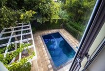 A Delight On Tranquil Boschenmeer Estate / One of the quietest streets within Boschenmeer is where you find this wonderful home for sale. Masterfully built and finished with a number of creature comforts this property showcases what it means to be able to call your house your home. What's more, the garden found just aft of the property ensures for privacy and coolness during the hot summer days. As the weather changes and the grey clouds thick with the possibility of rain draw ever nearer we head inside.