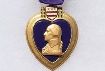 U.S. Purple Heart / Closeup view of the Purple Heart medal, which is a U.S.military decoration awarded in the name of the President to those wounded or killed, while serving, on or after April 5, 1917, with the U.S. military. With its forerunner, the Badge of Military Merit, which took the form of a heart made of purple cloth, the Purple Heart is the oldest military award still given to U.S. military members. / by Danny's History & Ancient Cash Coins