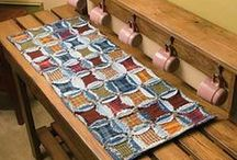 Table Runner (and more!) Quilt Patterns / Your table will look as good as your food tastes with these placemat, table runner, and home accessories kits and patterns that any quilter can do. / by Keepsake Quilting