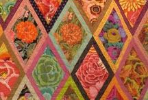 quilts and fabrics / by Cynthia Zink
