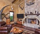 """TGB: Cordillera Trophy Room / Located in Boerne, TX and designed for a World Class Hunter, the Cordillera """"Trophy Room""""was created with the sole intent of showcasing one's passion of hunting trophy game from around the world. It features the use of stone, timber, glazed walls and stained concrete floors to create the perfect Man Cave environment."""