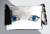 Mim & Ray | Jennifer / Crafted in silver metallic Italian pebble leather, the Jennifer has a bold modern design with a removable tassel keychain. The elegantly embroidered eyes and beautifully knit black alpaca wool will make a great conversation piece wherever you go. Embroidered eyes available in either blue or green. Proceeds benefit the Klein Life Community Center. featuring our bags, handbags, shoulder bags, leather crossbody, leather purses, leather handbags and leather handbags